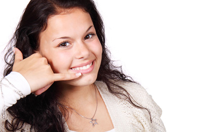 Young female gesturing a phone call